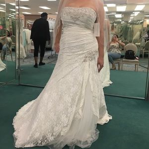 new wedding dress, tags intact size 16.